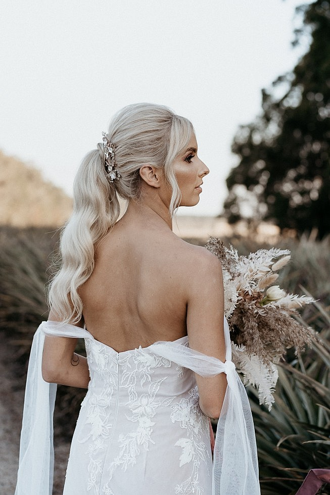 boho bride with long pony wedding hair style