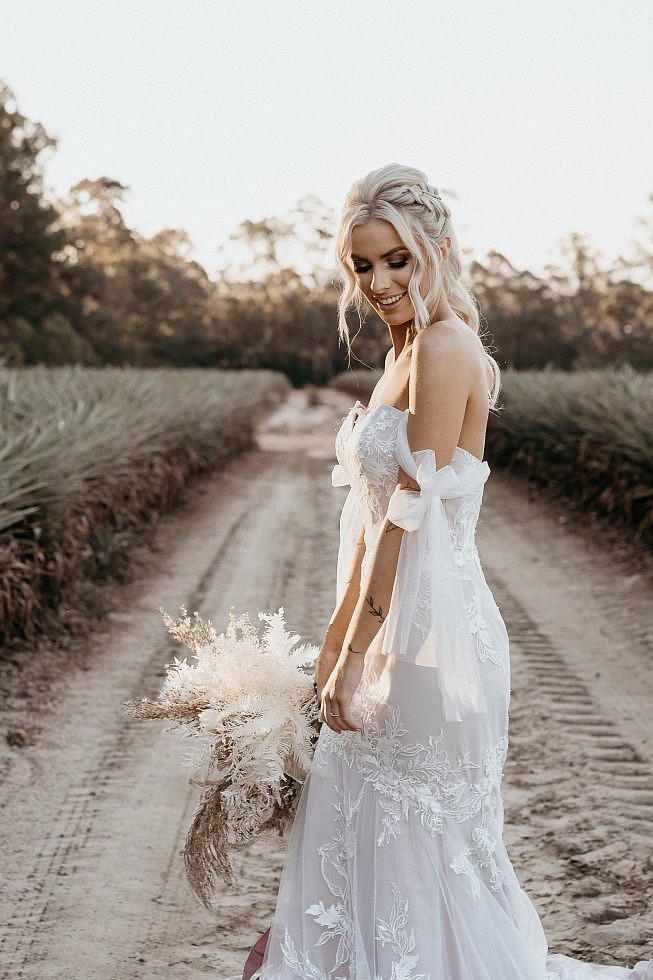 boho bride with high pony hair style and braid feature