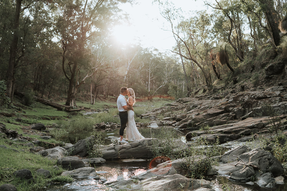 couple kissing in the middle of a flowing river